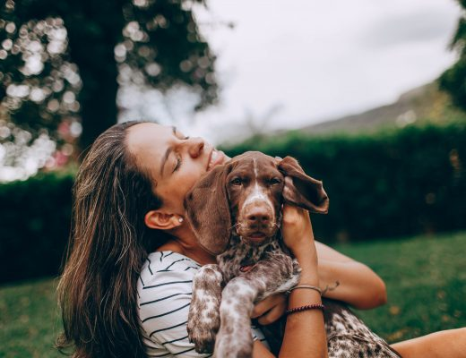 girl smiling with beautiful puppy
