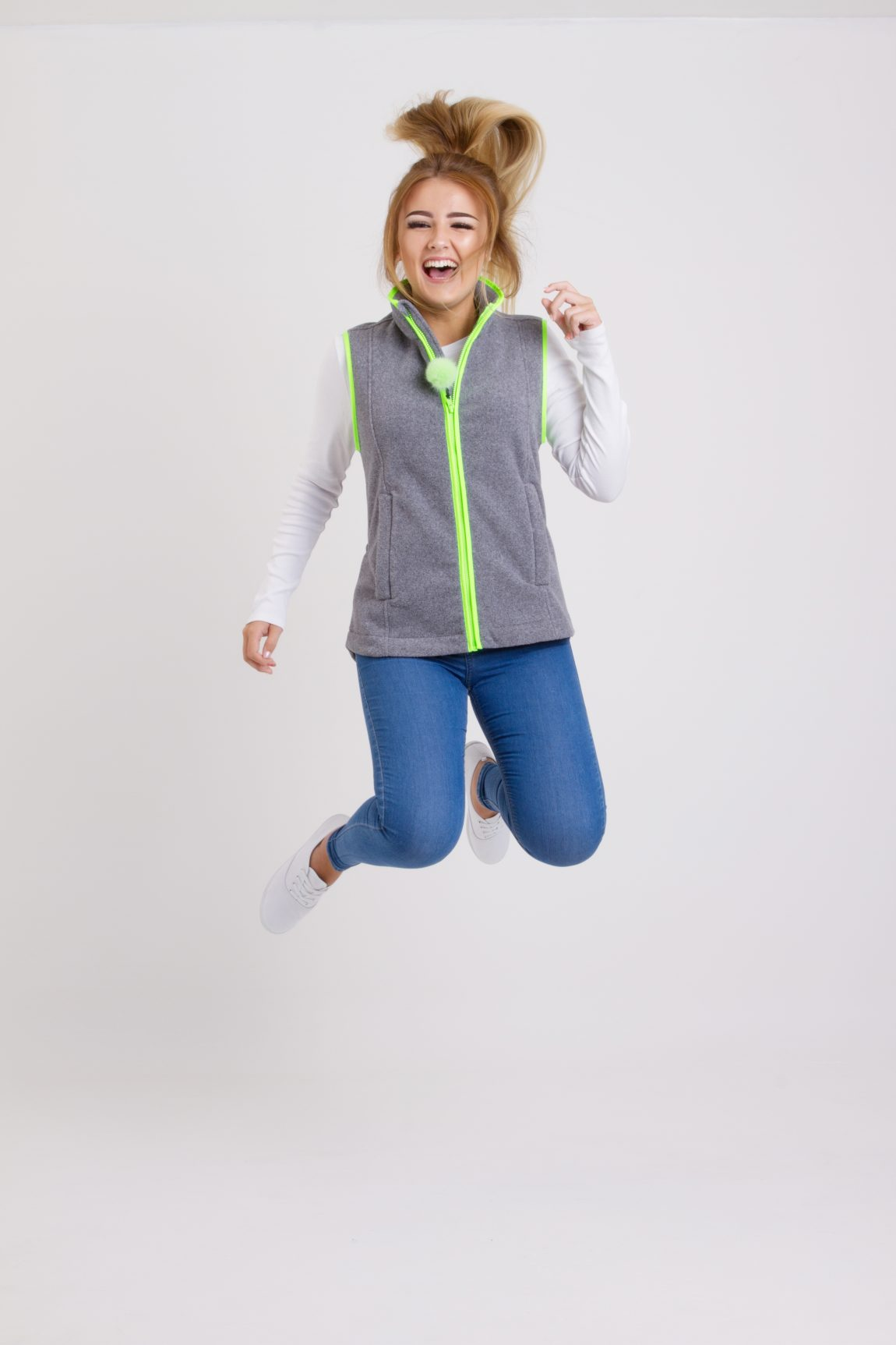 girl jumping in nattily dressed gilet